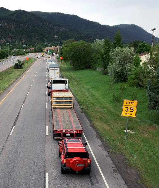 Traffic backs up on eastbound Interstate 70 on Thursday morning at the Glenwood Springs exit after the Colorado Department of Transportation closed the road because of a rockslide in Glenwood Canyon.