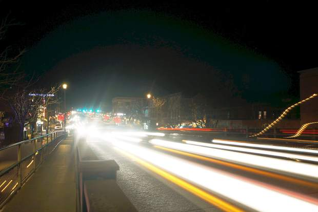 Christopher Mullen Post Independent Traffic flows across the Grand Avenue Bridge in Glenwood Springs, Thursday night.