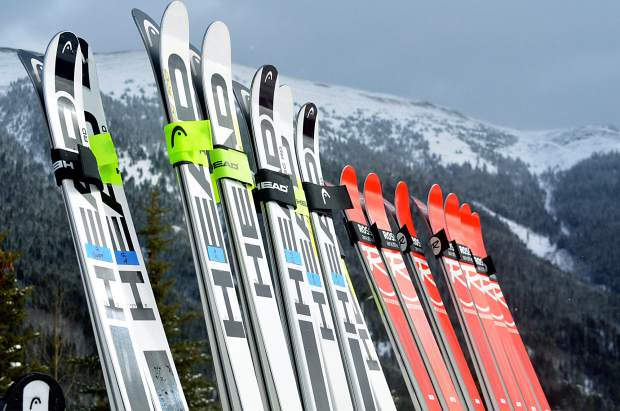 A typical ski team quiver at the base of Copper Mountain during early-season training in mid-November.