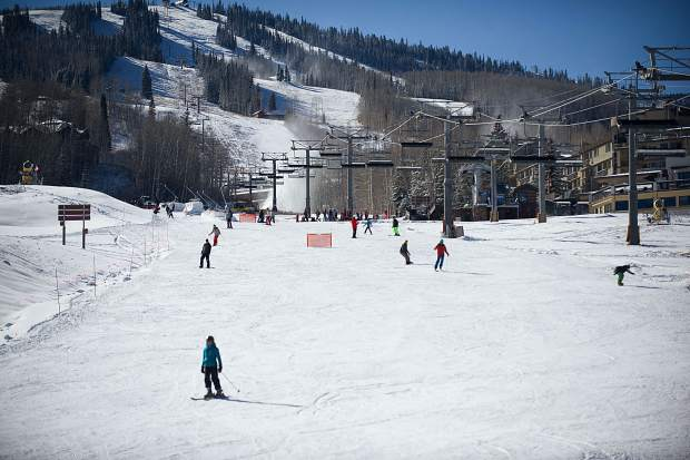 Skiers and snowboarders enjoy opening day at Snowmass on Thursday as they come down Fanny Hill.