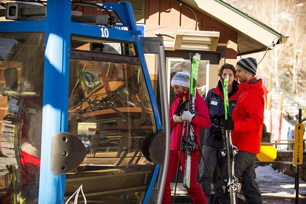 Guests board the gondola at Fanny Hill for Snowmass' opening day on Thursday.