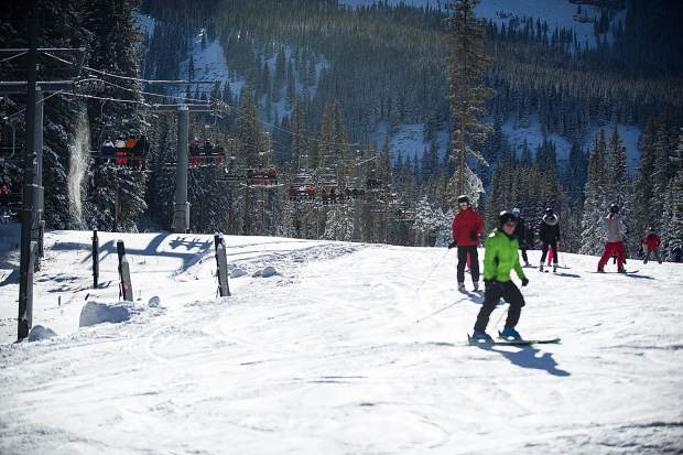 Skiers and snowboarders enjoy the Meadows at Snowmass on opening day this Thursday..