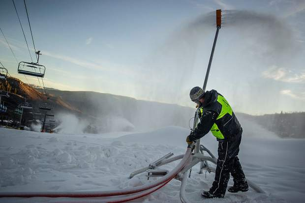 Snowmaker Justin George working on snow guns in Snowmass on Saturday the 19th in preparations for opening day.