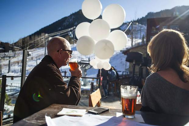 Guests enjoy beers and a view of Aspen Mountain at Shlomo's Deli and Grill on Friday.