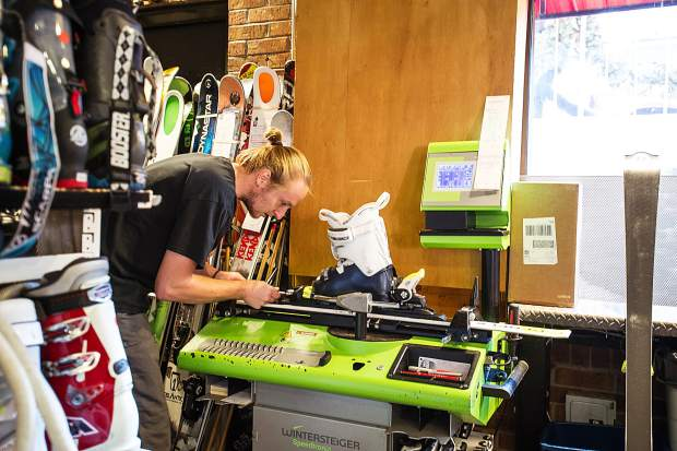Justin Greene preps skis at Hamilton Sports in Aspen on Friday afternoon.