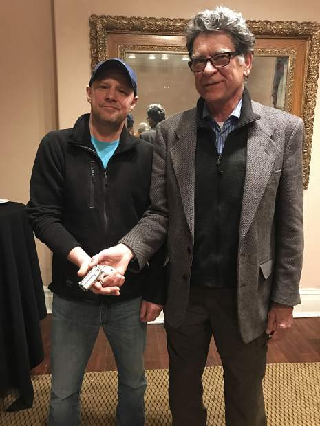 Jason Brierley of Vancouver, Canada, met with Glenwood Springs Historical Society members, including Executive Director Bill Kight, Wednesday at the Hotel Colorado. Brierley sold Doc Holliday's derringer to the group Thursday.