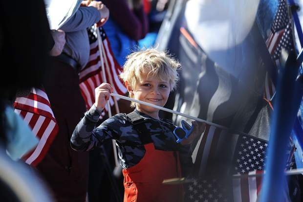 A little boy in the crowd holds his American flag at the World Cup finals in Aspen on Sunday.