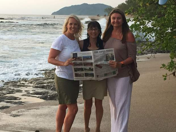 Basalt residents Kara Lizotte, Jana Dillard and Clarissa Mcmahon took in The Aspen Times on a trip to Langosta Beach, Costa Rica, in May. Email your