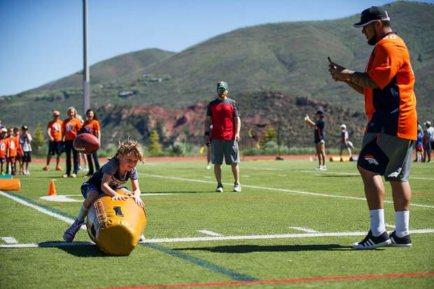 Clementine Mitchell, 7, at the Broncos' camp at Aspen High School Saturday morning.