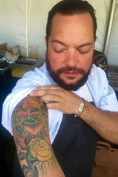 Chef Jean-Philippe Gaston shows his meaningful tattoo sleeve.