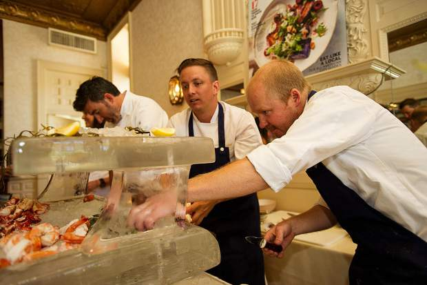 Chefs at the raw bar at A Bubbly Brunch hosted at the Hotel Jerome on Sunday.