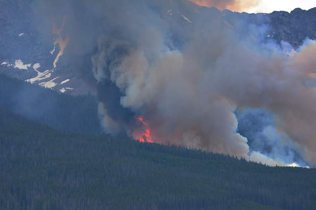 A wildland fire burns Wednesday in Breckenridge. The fire has forced the evacuation of a nearby neighborhood.