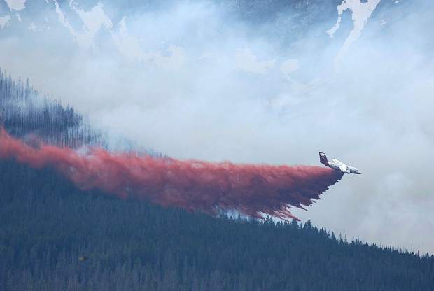 An air craft works as a wildland fire burns Wednesday in Breckenridge. The fire has forced the evacuation of a nearby neighborhood.