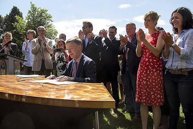 Gov. John Hickenlooper signed an executive order Tuesday morning near Denver to announce Colorado's entry into the U.S. Climate Alliance with a dozen other states and Puerto Rico to adhere to the Paris Agreement on climate change standards, with or without the federal government.