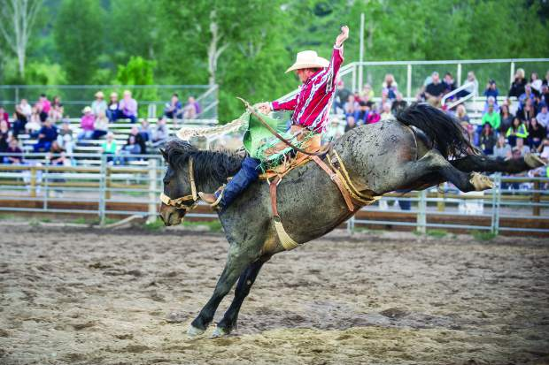 Garrett Buckley after winning the saddle bronco competition at the first summer Snowmass Rodeo on June 14, 2017.
