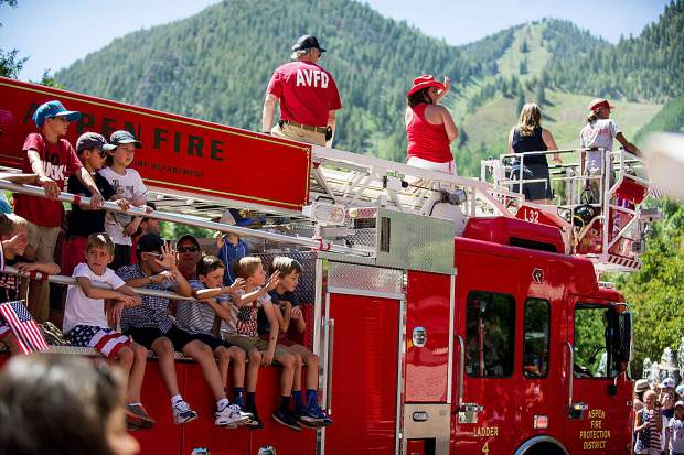 A group on the Aspen Firetruck float in the Aspen parade on Tuesday.