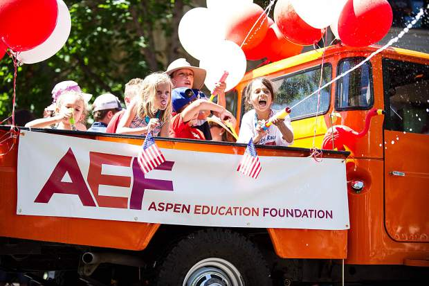 Children on a float in Aspen's parade on Tuesday.