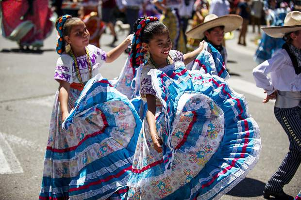 Aspen Santa Fe Ballet Folklorico students in the Aspen parade on Tuesday.
