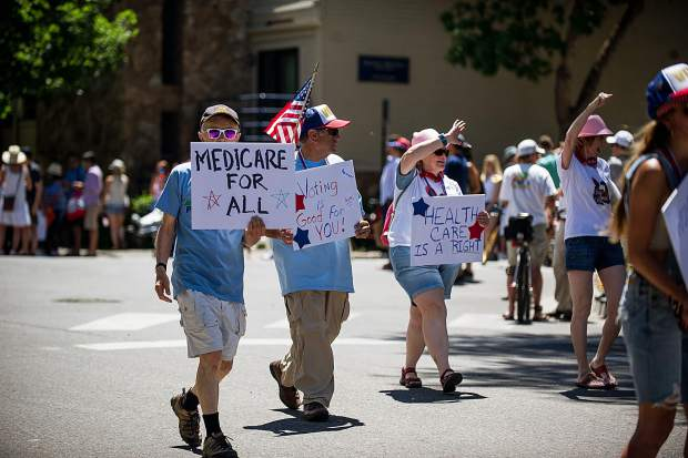 Medicaid supporters in the Aspen Parade Tuesday.