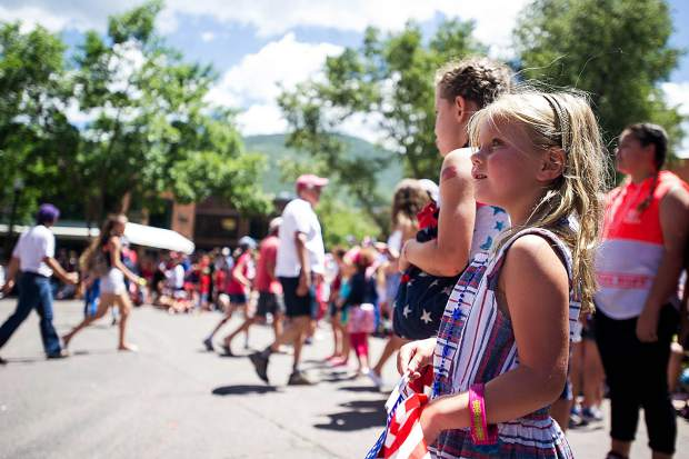 A little girl on the corner of Hyman Ave. during Aspen's parade on Tuesday.