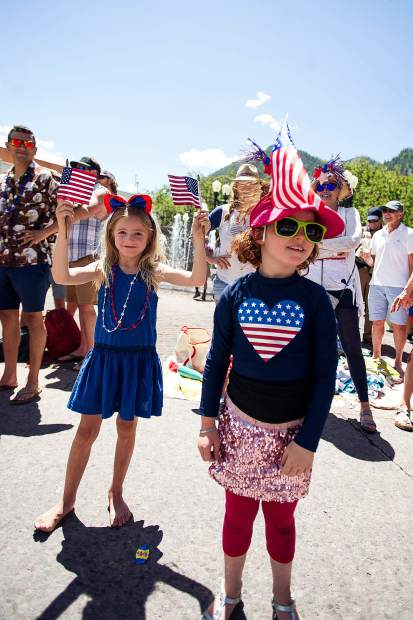 Gracie Rudolph, 7, and Hazel Peck, 6, at Aspen's parade on Tuesday.