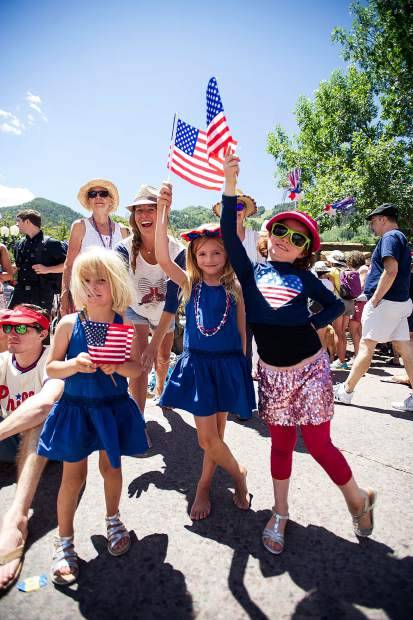 Right to left Gracie Rudolph, 7, and Hazel Peck, 6, and Hadley Peck, 3, at Aspen's parade on Tuesday.