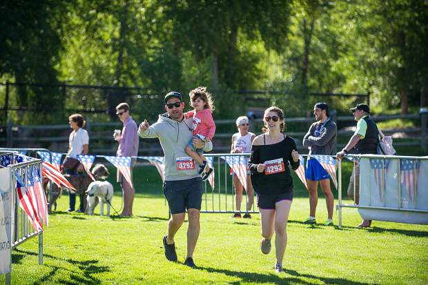 A family races to the finish for Boogie's Buddy Race on Tuesday at Rio Grande Park in Aspen.