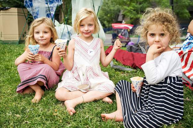 From left to right, Ellie Golden, 3, Elise Nemecheck, 5, and Mary Golden enjoy snowcones at the AVSC picnic at Koch Park in Aspen on Tuesday.
