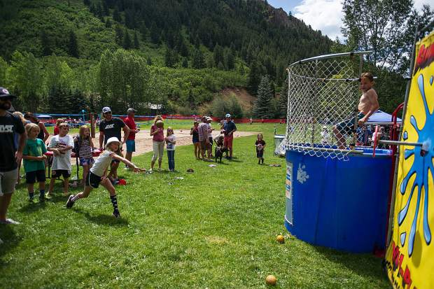 Gracie Feinberg, 10, throws a ball to hit the dunk tank at the AVSC picnic at Koch park in Aspen on Tuesday.
