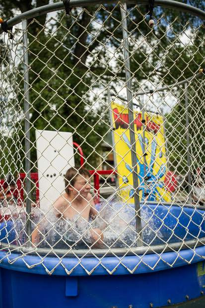 Nick Hearn, 11, gets dunked at the AVSC picnic at Koch park in Aspen on Tuesday.