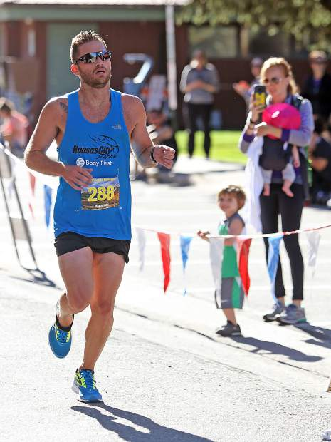 With his family cheering him on, Kory Cool of Manhattan, Kansas, is the first to cross the finish line Saturday at the 2017 Aspen Valley Marathon in Basalt. Cool won the 26.2-mile race in 2 hours, 38 minutes, 17 seconds.