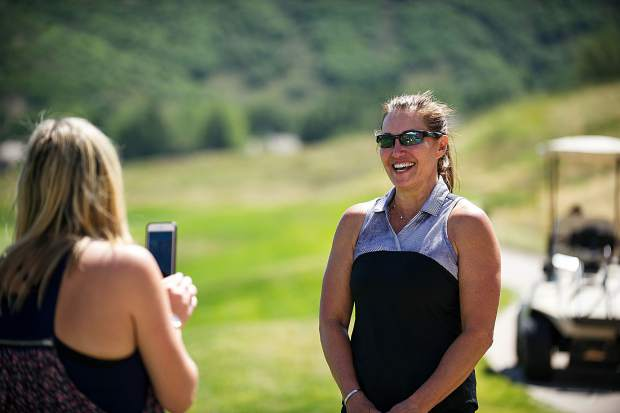 Nicki Cader, right, got a hole in one at the Snowmass Club for the Challenge Aspen benefit known as the Vince Gill and Amy Grant 14th Anniversary Gala and Golf Classic on Tuesday.