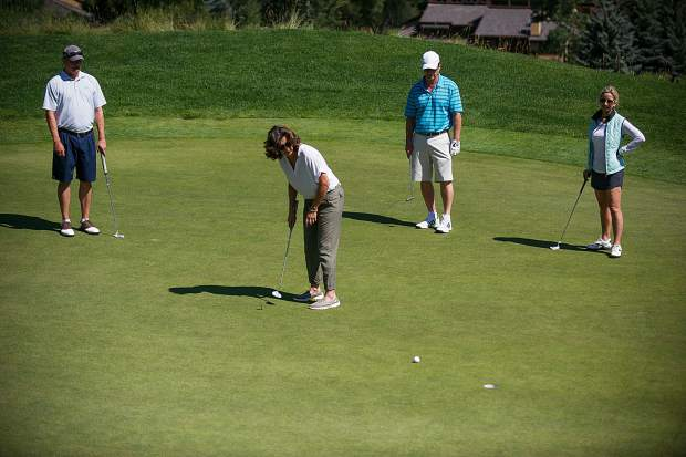 Singer Amy Grant putts at hole 7 at the Snowmass Club for the Challenge Aspen benefit known as the Vince Gill and Amy Grant 14th Anniversary Gala and Golf Classic on Tuesday.