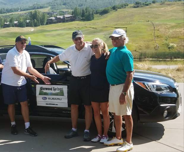 Country singer Vince Gill, left, jokes around Tuesday after Bob Devan, right, won a car with a hole-in-one at the Challenge Aspen golf fundraiser. Devan, 71, of Basalt had one of three aces register Tuesday at the Snowmass Club event, but his was the only one that gardnered a new ride.
