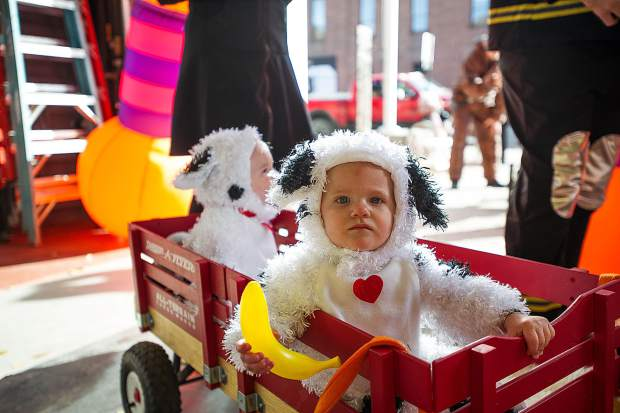 James, front, 1, and his brother Wallace are dressed as dalmations at the Elks Lodge event held at the Aspen Fire Department