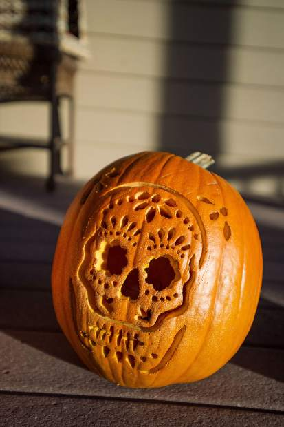 A carved pumpkin at the Hancock house for trick or treating in the North 40 neighborhood in Aspen.