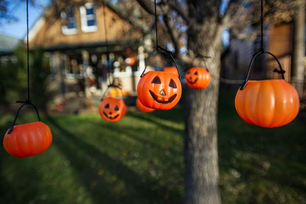 Pumpkins hang outside a tree at the Hancock household in the North 40 neighborhood on Tuesday for Halloween.