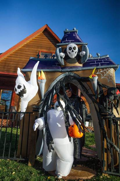 Rome Wiley, 7, trick or treats in the North 40 neighbordhood on Tuesday for Halloween.