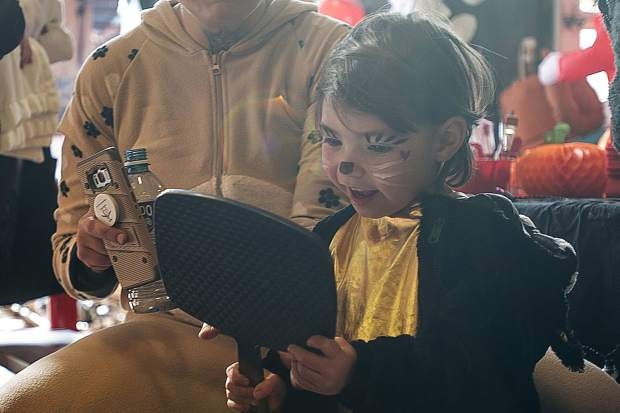 Layla Nott, 3.5, gets her face painted at the Aspen Fire Station