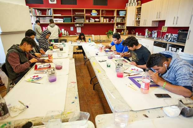 Students working on their self portraits for the mural on November 2 at the Basalt Art Base.