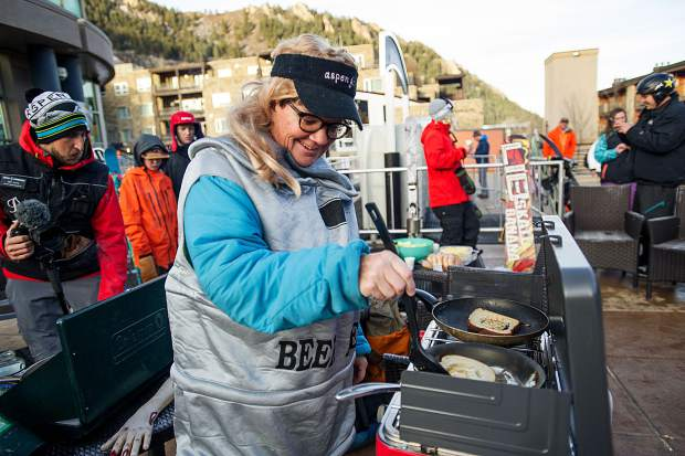 Swiller cooks up some breakfast at the base of Aspen Mountain for the