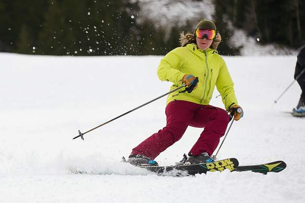 Jackie Welgos coming down The Little Nell run Thursday for opening day on Aspen Mountain.