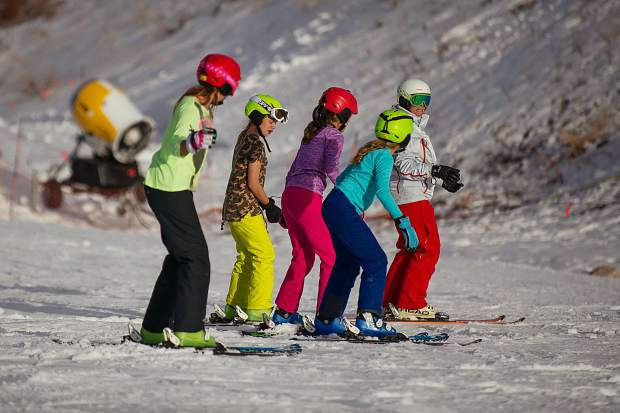 Ski school makes their way down Fanny Hill Thursday afternoon of Snowmass Mountain's opening day.