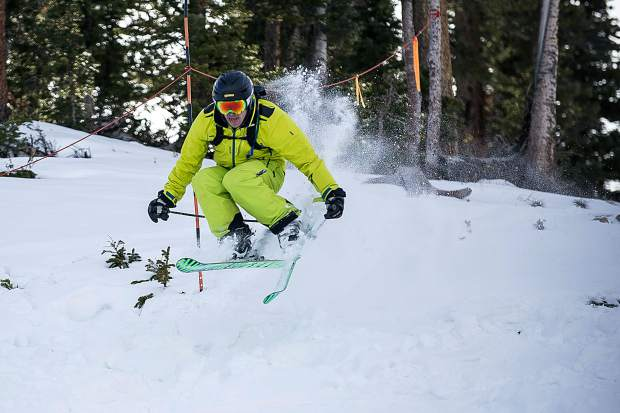 A skier pops off a side feature on Aspen Mountain on opening day on Thursday.