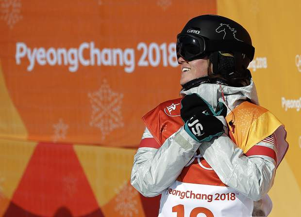 Arielle Gold, of the United States, reacts to her score during the women's halfpipe finals at Phoenix Snow Park at the 2018 Winter Olympics in Pyeongchang, South Korea on Tuesday, Feb. 13.