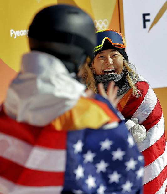 Gold winner Chloe Kim, of the United States, and bronze winner Arielle Gold, of the United States, celebrate after the women's halfpipe finals at Phoenix Snow Park at the 2018 Winter Olympics in Pyeongchang, South Korea, Tuesday, Feb. 13, 2018. (AP Photo/Lee Jin-man)