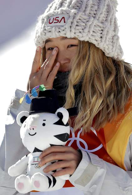 Chloe Kim, of the United States, wipes away a tear after winning gold in the women's halfpipe finals at Phoenix Snow Park at the 2018 Winter Olympics in Pyeongchang, South Korea, Tuesday, Feb. 13, 2018. (AP Photo/Lee Jin-man)