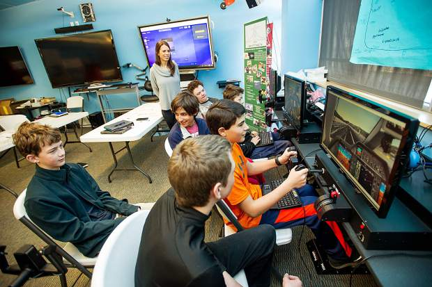 8th grade students in Keri Benton's aviation class at Aspen Middle School working on the flight simulators in their classroom on Thursday.