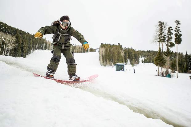 Marcus Kates snowboards through some melted snow on Sunday at Aspen Highlands for closing day.