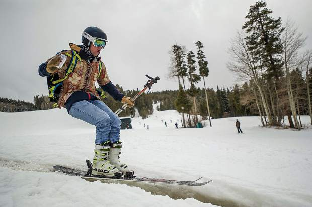 A skier skis through some melted snow on Sunday at Aspen Highlands for closing day.